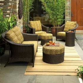 Outdoor wicker lounge furniture on bamboo rug, resin wicker lounge chairs, all weather patio furniture.