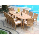Teak patio dining set on stone patio beside pool, teakwood outdoor furniture, wooden outdoor furniture.