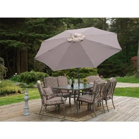 Six piece luxury patio set with umbrella on stone patio, designer patio set, outdoor dining sets.