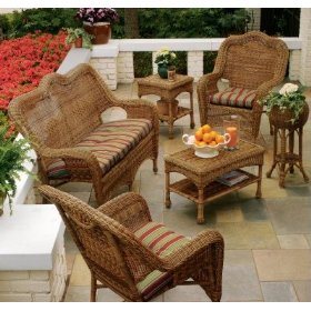 Wicker couch/sofa and two chairs with coffee table on porch, resin wicker outdoor furniture, wood outdoor furniture.