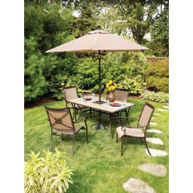 Patio set with four chairs on grass with open umbrella, patio furniture umbrella, outdoor umbrella.